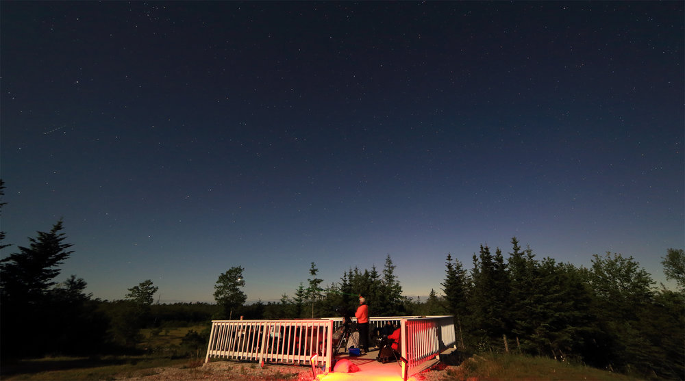 Tim indicates a fireball meteor (outside the frame) with his green laser pointer.