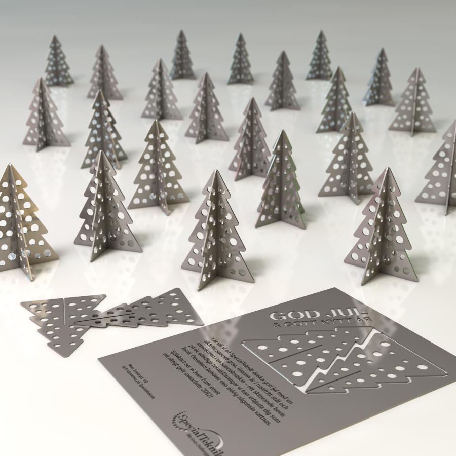 Julgåva: Laserskuren rostfri plåt med både julhälsning och barrfri gran.