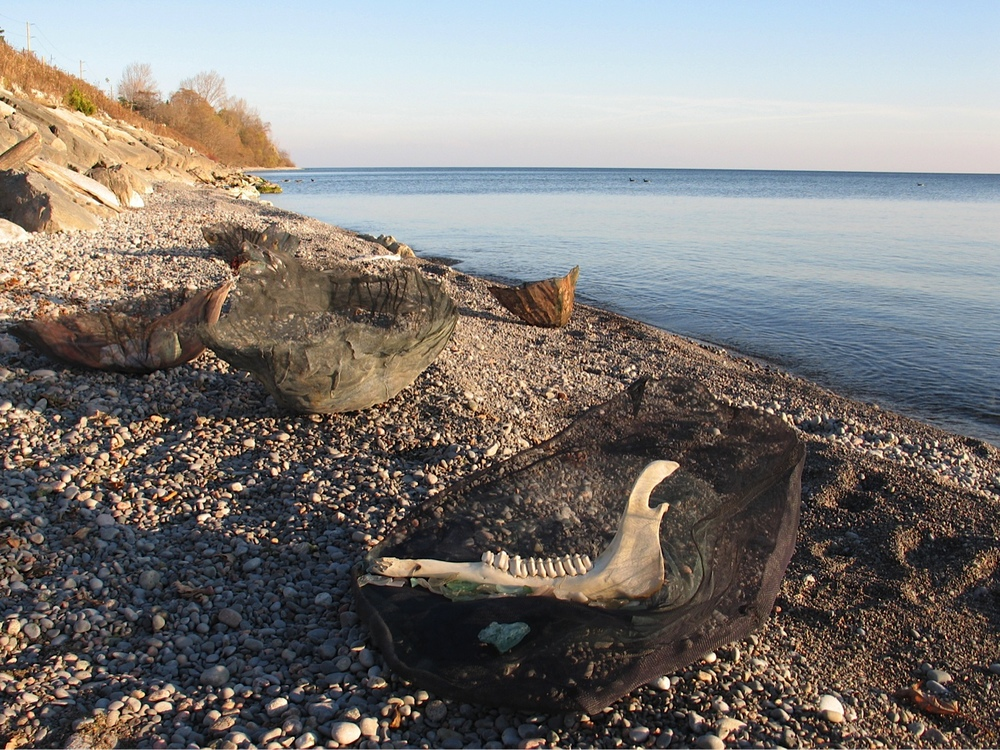 Vessels Group on Lake Ontario Beach,2009 Mixed media in pressed aluminum screening, dimensions variable