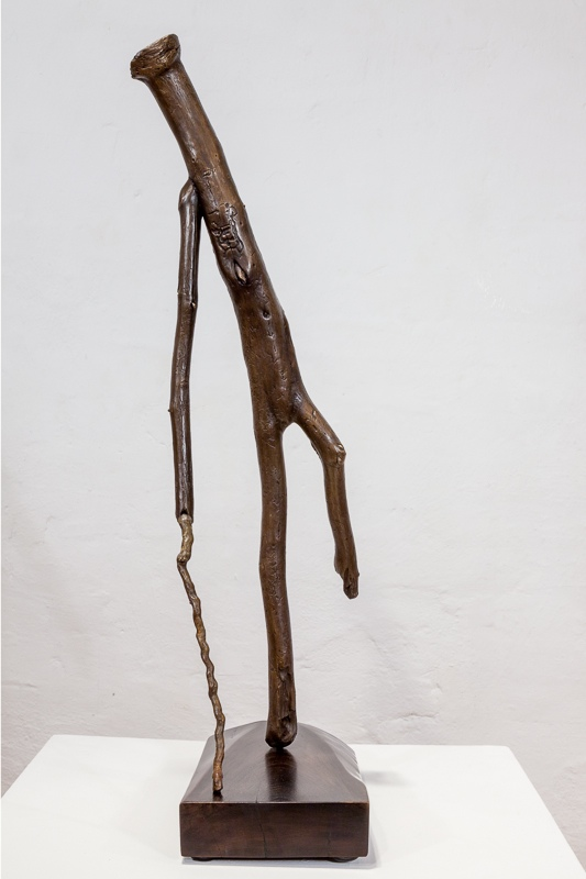Walks With Cane  cast bronze, 67 x 23 x 20 cm,  2011 - 12 walnut base, steel dowel 5 x 16 x 30 cm,  2012