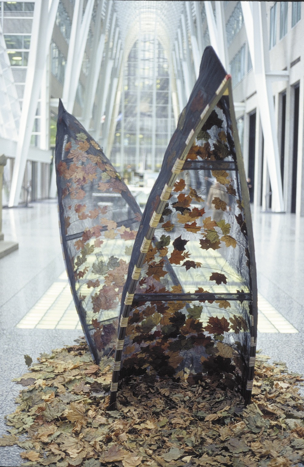 Oh, Canada,  2003 Aluminum window screening, maple leaves, white pine gunnels, communication wire, steel, 240 x 480 x 150 cm (installed)