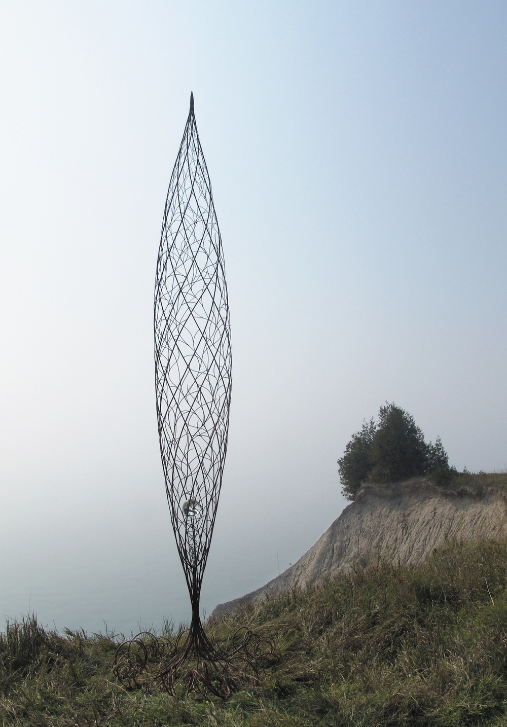 Genesis  , 2003-2004  steel rods, primer, crystal ball/egg, 480 x 120 cm