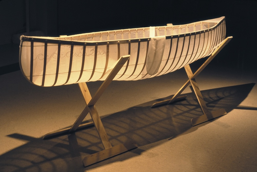 Learning Canoe , 1998 Silk organza, birch veneer ribbing, tailor's chalk, embroidery, mother of pearl buttons, steel pins, pine cradle 92.5x240x 60cm