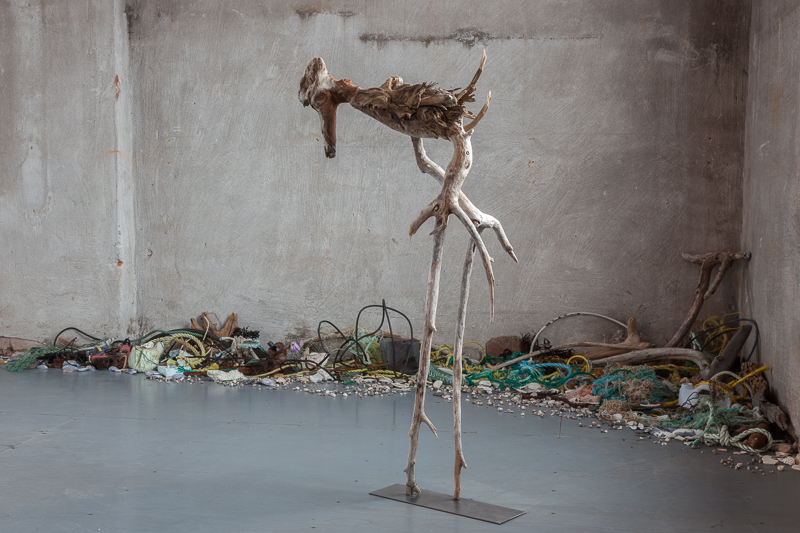 Old Bones , 2011 Newfoundland & Lake Ontario driftwood with Flotsam and Jetsam on floor, 110 x 60 x 26 cm
