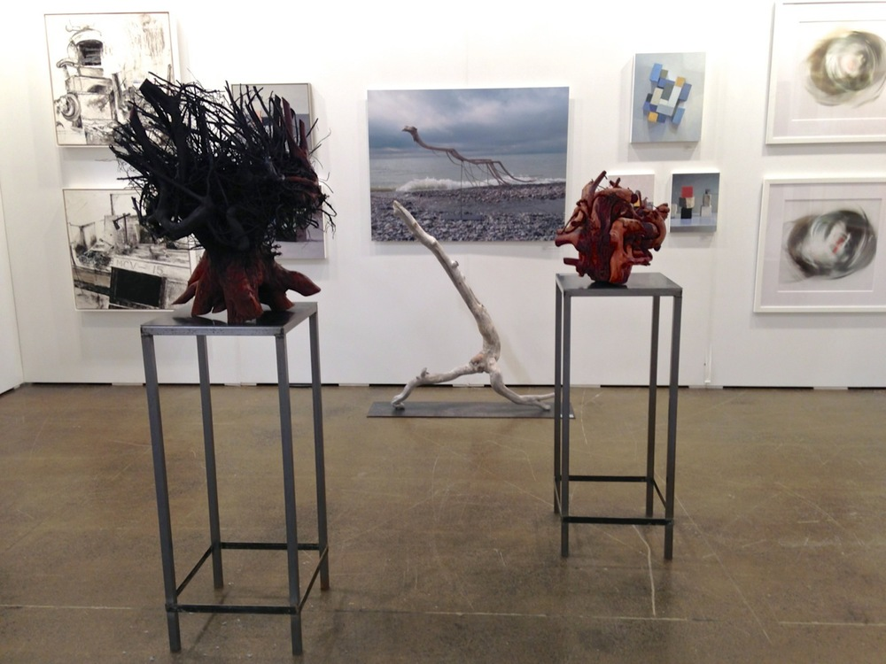 Installation view, sculptures: left to right,  Black Madonna, Strider, Agony. Photograph, centre: Swimmer