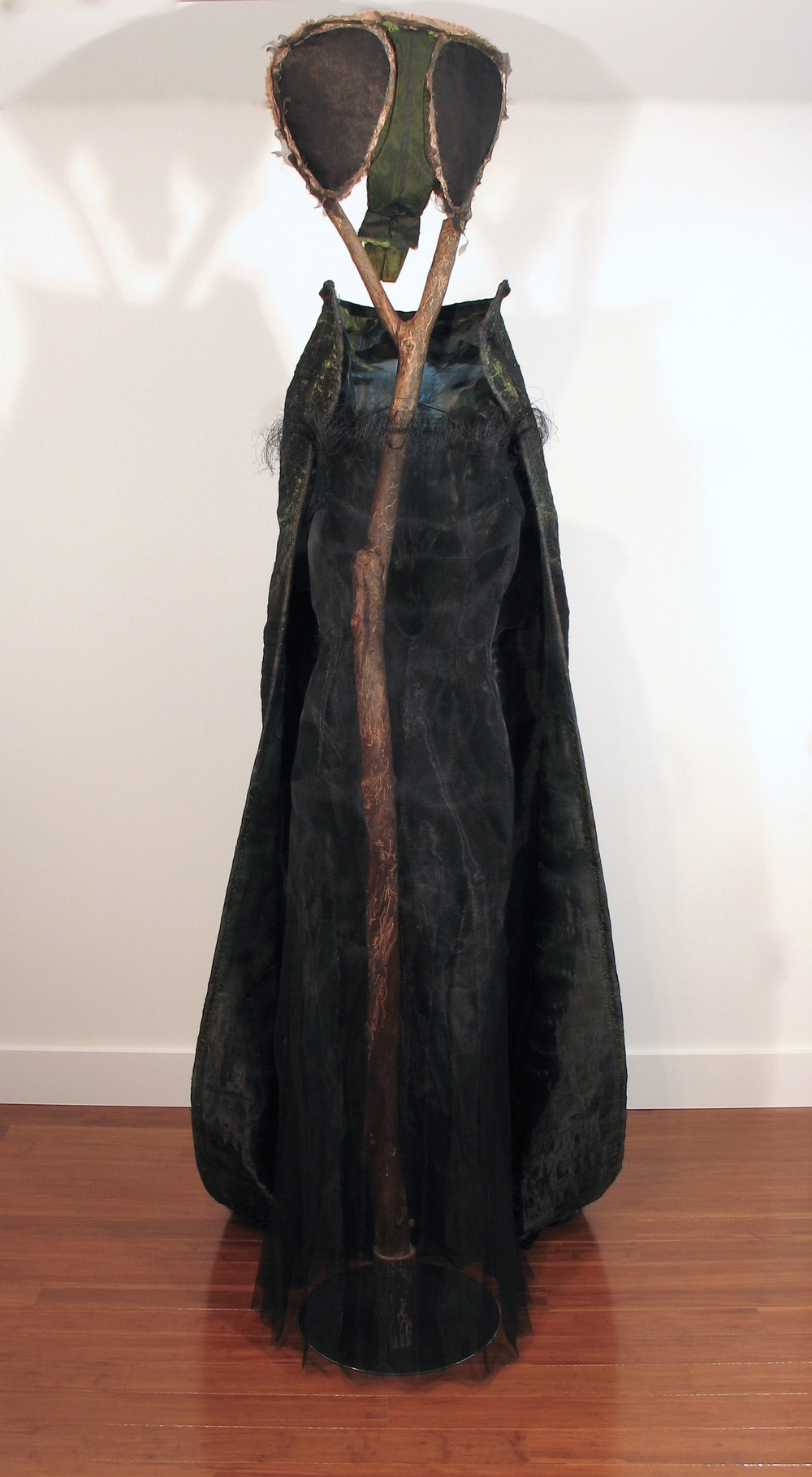 "Systems Failure II: Mother Nature Is Always Speaking  , 2002 - 2015 fabrics, paints, threads, tree limb, black aluminum screening, tree limb, steel  88"" x 30"" x 48"""