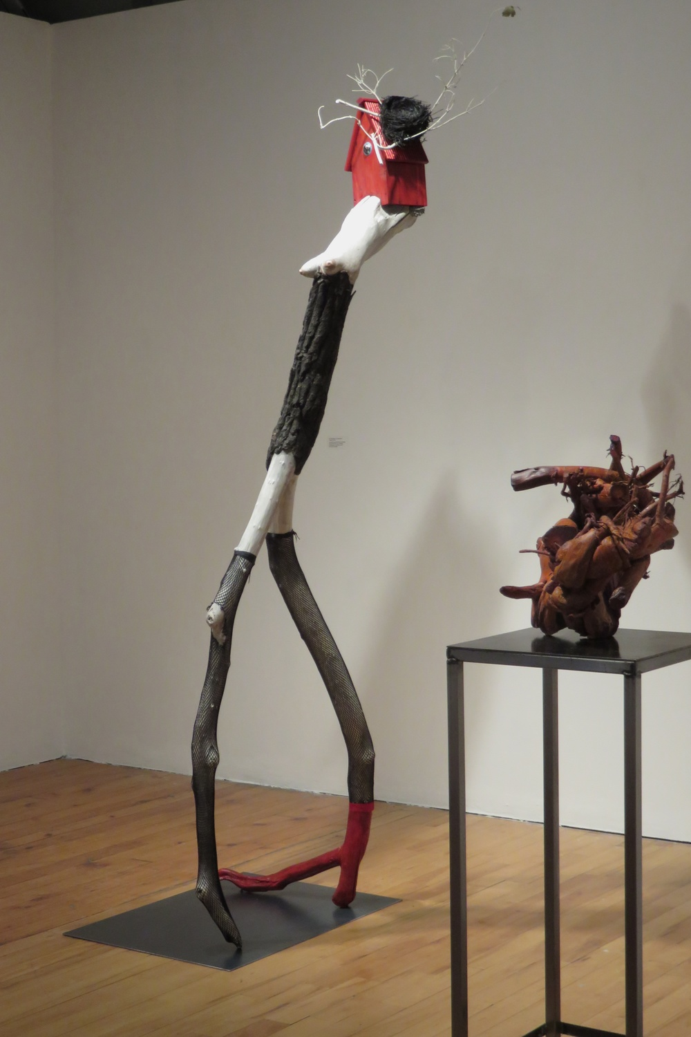The Fascinator , 2015 Tree limbs, wood bird house, LED light, glass, bird's nest, nylon stockings, acrylic paints, wood stain, 96 x 30 x 32 inches Stands on a steel base on the floor