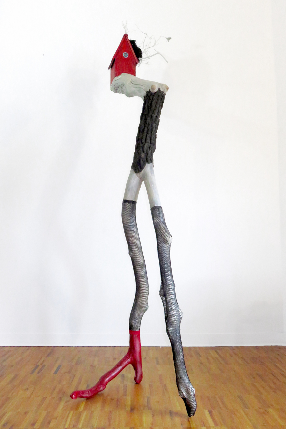 The Fascinator, 2015 Tree limbs, wood house, LED light, glass, bird's nest, nylon stockings, acrylic paints, wood stain, 96 x 30 x 32 inches