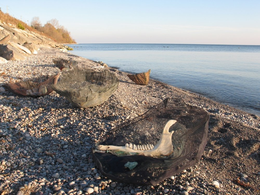 Vessels Group on Lake Ontario Beach,  2009  Dimensions variable, Mixed media in pressed aluminum screening