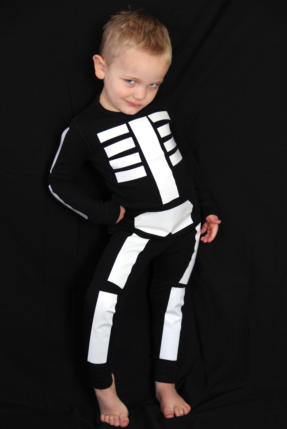 A few months ago Elliott decided he wanted to be a skeleton. So I started planning out the costume and came up with this! Of course in true four year old ...  sc 1 st  And We Play & DUCT TAPE SKELETON COSTUME u2014 And We Play | DIY For Kids