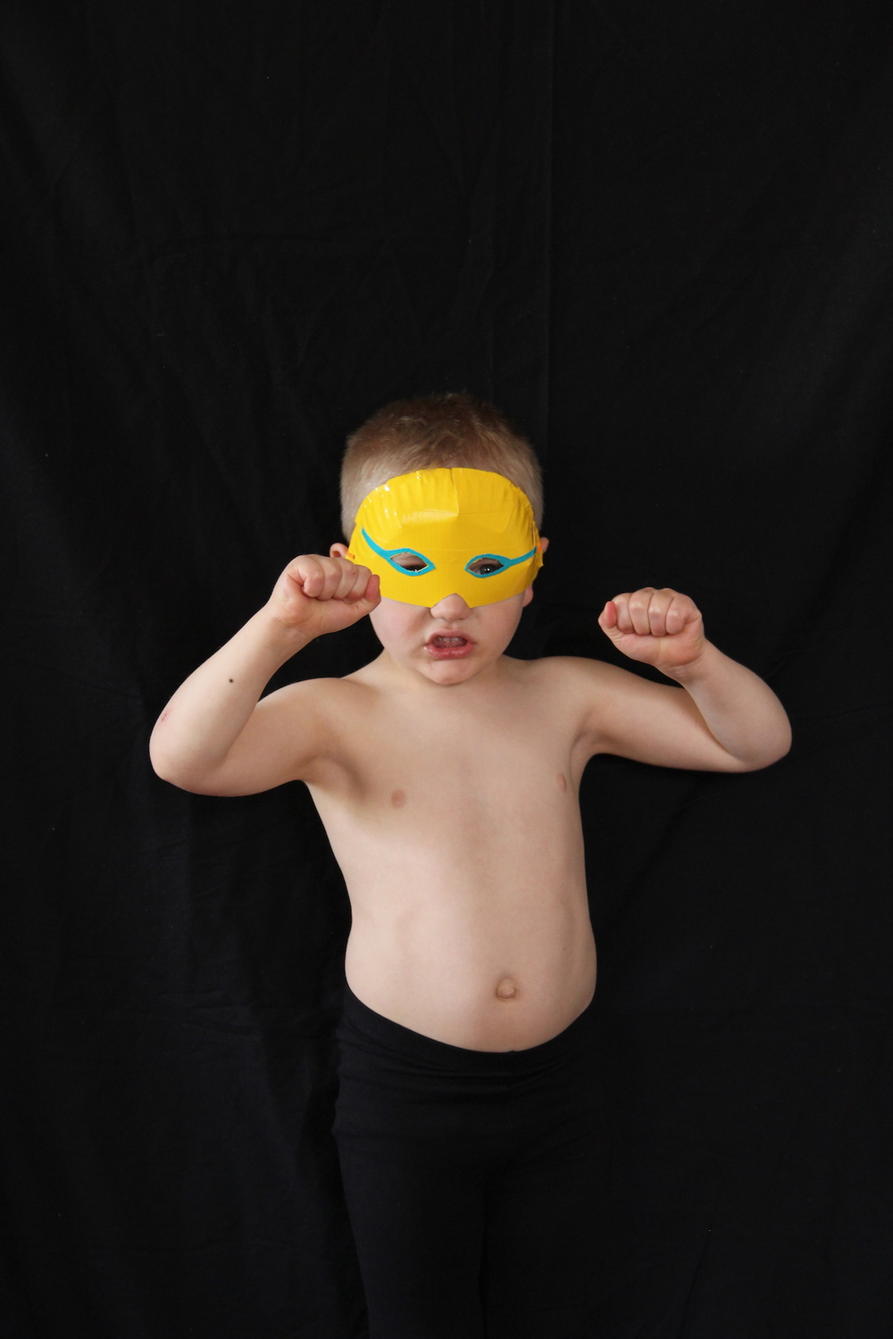 Make your own luchador masks with paper plates and duct tape!