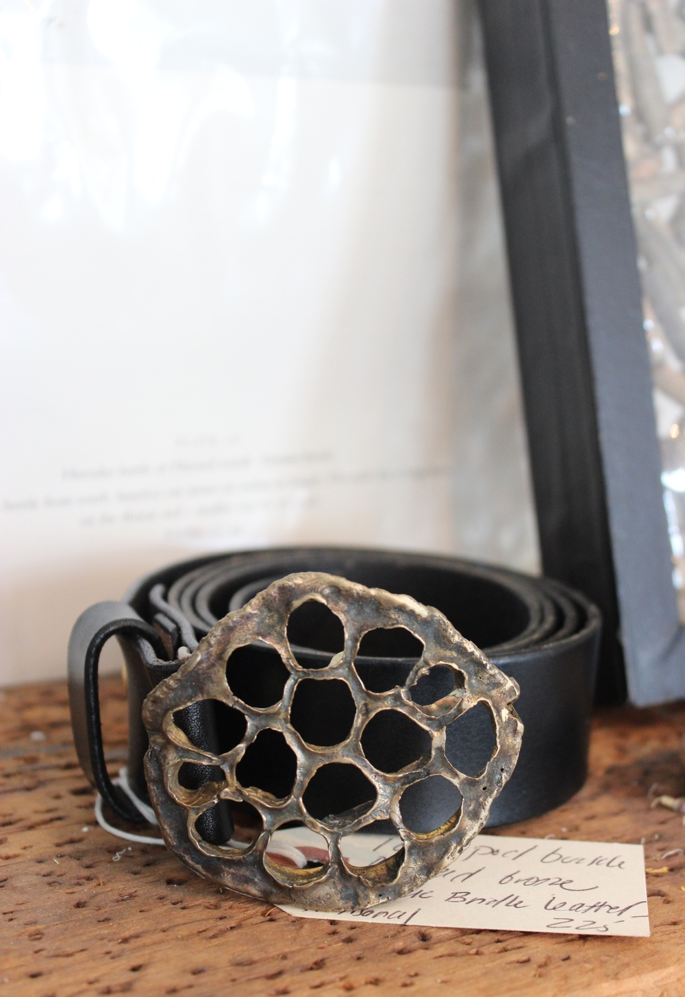 This belt buckle is reminiscent of Alexander McQuinn's honeycombs.   Its the skeleton of a lily pod.
