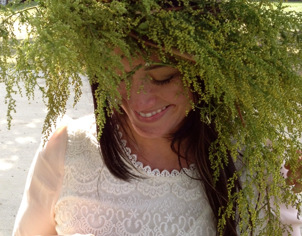 My green fro.  The flower wreath making is my favorite thing to do at the festival.  Its a great keepsake for the girls.