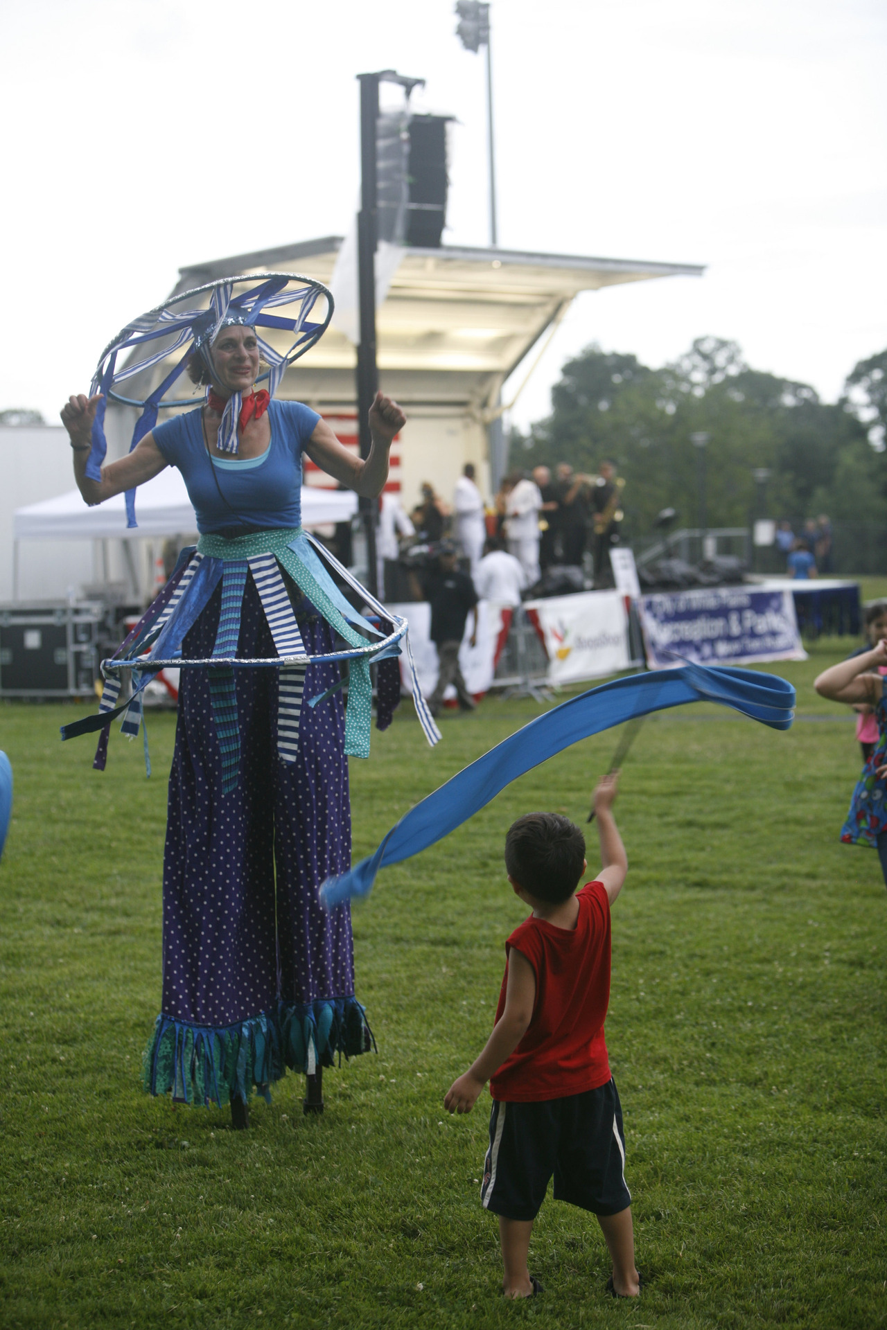 Daniel Minchala of Elmsford twirls a ribbon with performer Therese Schorn before the fireworks show at White Plains High School July 2, 2013. (Dave Gershgorn/ The Journal News)