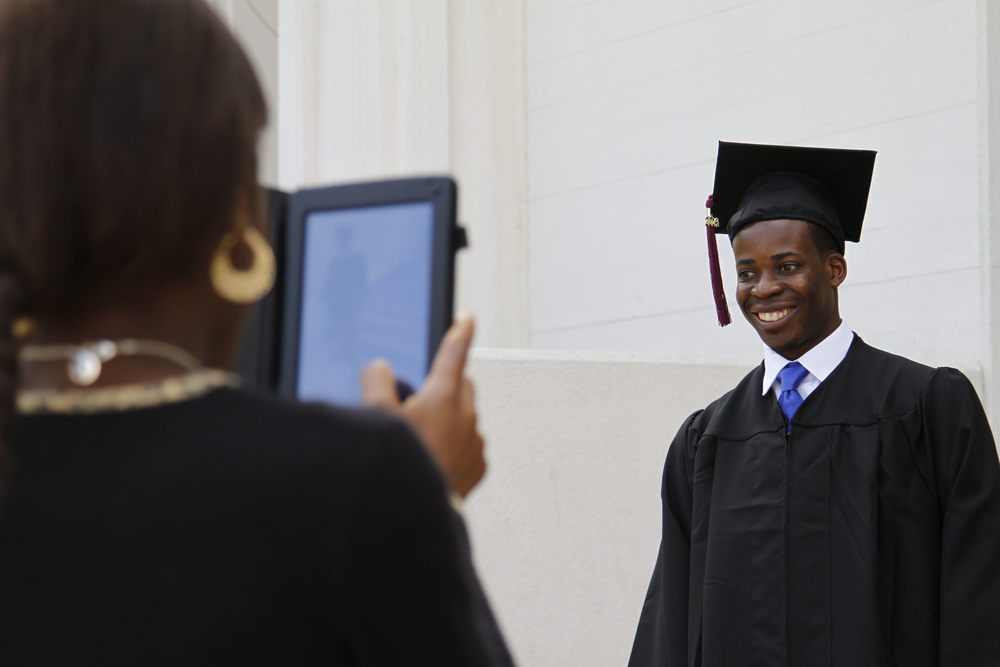 Graduate Reginald Hilaire poses for a photo before he graduates at The College of Westchester's 98th Commencement Ceremony May 29, 2014.