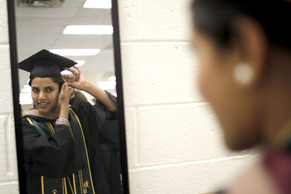 Madiha Kanawal fixes her cap before The College of Westchester's Commencement Ceremony May 29, 2014.