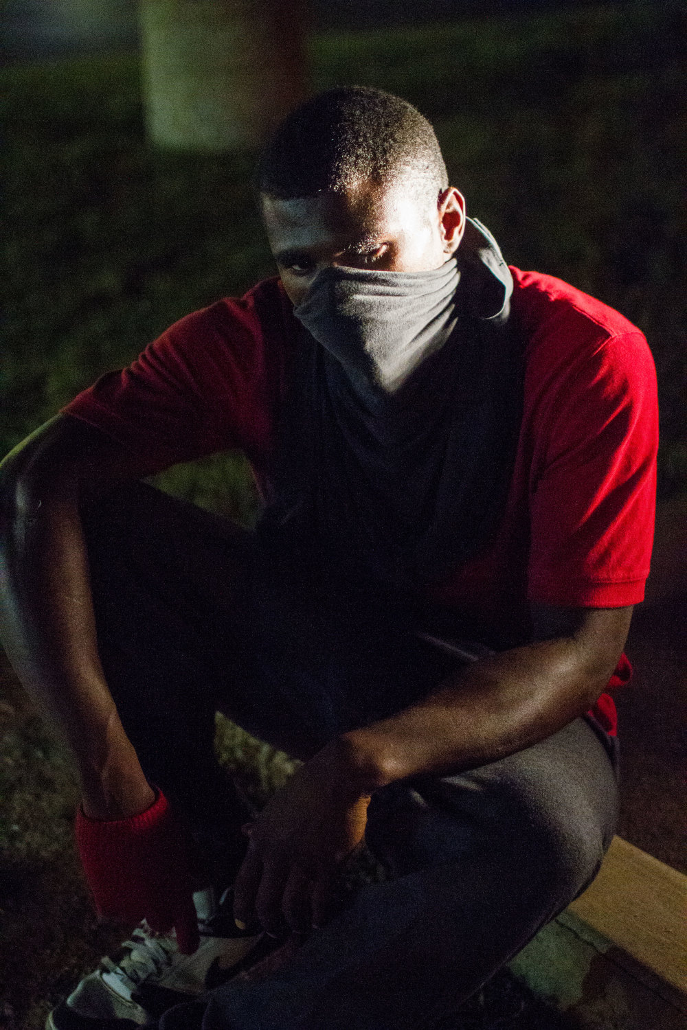 A protester covers his face with a bandana in Ferguson, Mo., after the police killing of unarmed Michael Brown. (Dave Gershgorn)