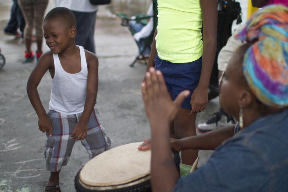 A boy dances to drums during a protest for Michael Brown, an unarmed 18-year-old killed in Ferguson, Mo. (Dave Gershgorn)