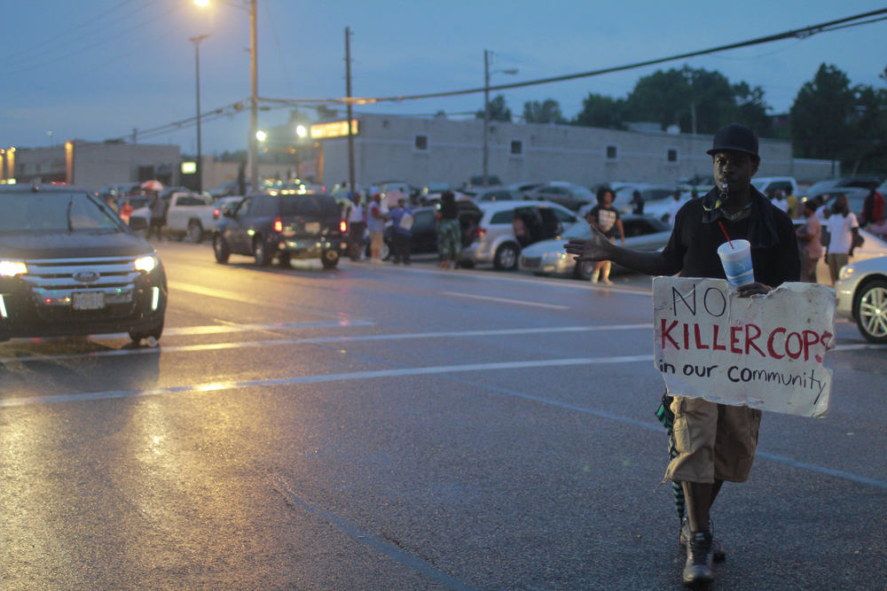 A protester directed traffic to help with a heavy flow of cars Friday, in Ferguson, Mo. (Dave Gershgorn)