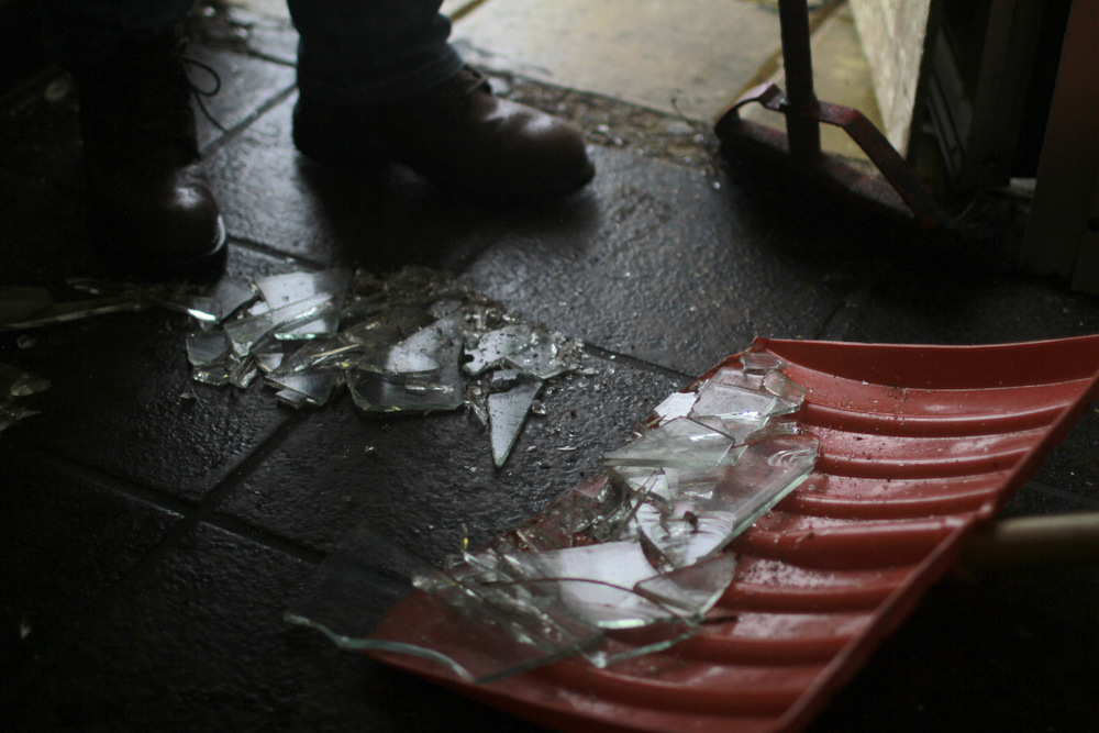 Broken glass litters the floors of many Ferguson businesses after Friday night's looting. (Dave Gershgorn)