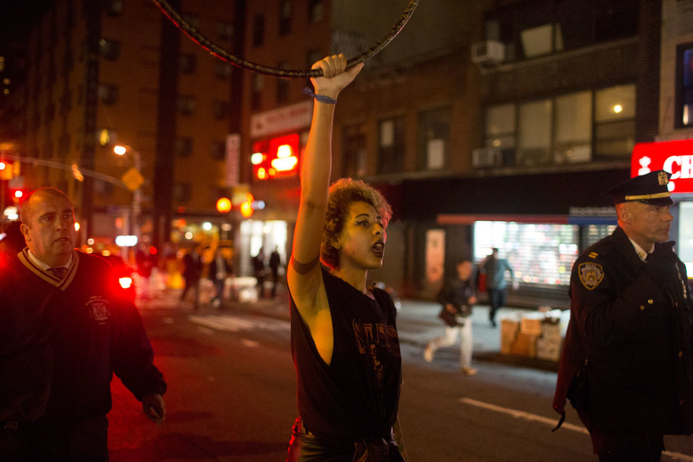 A protestor raises her hula hoop during the Nov. 24 march against the decision of 'no indictment' in Ferguson, Mo.