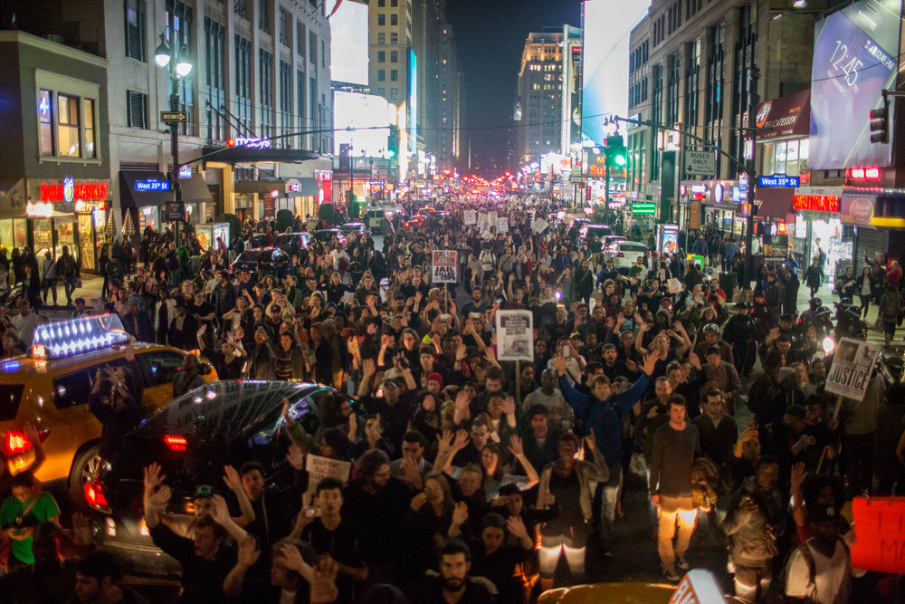 Protestors flooded 7th Avenue of NYC after Darren Wilson was not indicted for the shooting of Michael Brown.