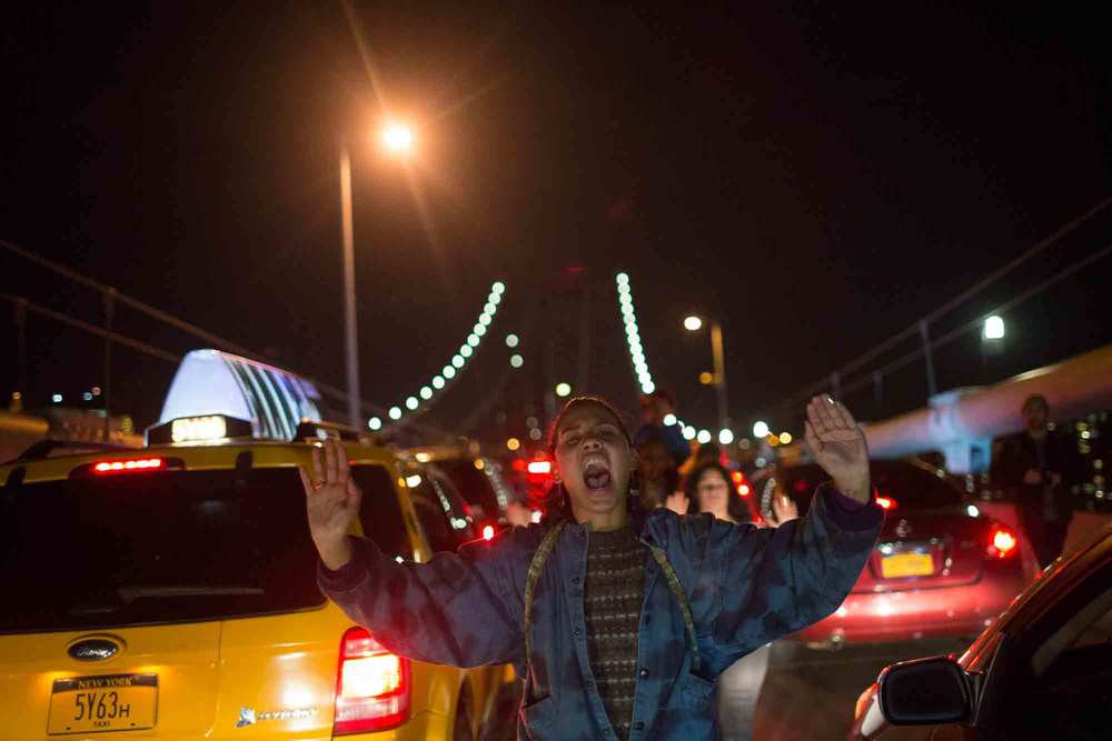 Sarah Lawrence senior Amimta Dawson shouts as she leads protestors over the Manhattan Bridge in New York City Tuesday.