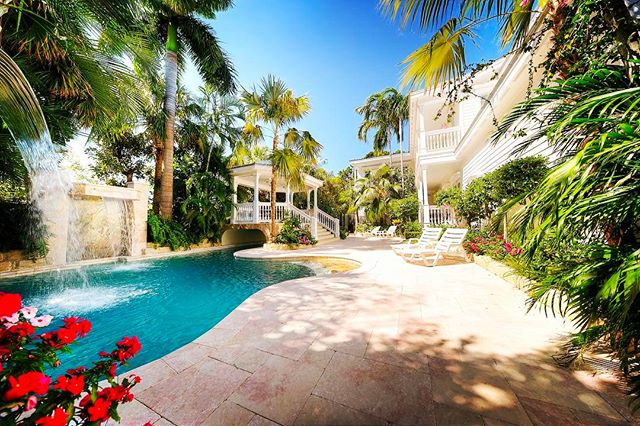 NEW LISTING WEDNESDAY!  1400 1ST Street, Key West | $2,495,000  Listed Exclusively By: Team Spottswood/Vazquez & Terri Spottswood  Magnificent & manicured, this mid town stunner nestled behind its privacy walls will amaze and delight. 5BR/4BA, luxurious in every way from the solid Brazilian cherry floors, gourmet kitchen with granite countertops, stainless appliances including sub-zero and six burner Viking gas range, entertainers bar made of mahogany, hand-selected tile in every bathroom, hand-made wainscoting and custom crown molding. Every detail was considered with the highest quality and craftsmanship. Resort caliber pool and spa surrounded by tropical lush landscaping features 2 waterfalls and a swimming lagoon connected to the whirlpool/spa by a 52 ft canal bridged by a fabulous dining gazebo. Two car garage and plenty off-street parking.  Listed Exclusively By: Team Spottswood/Vazquez & Terri Spottswood  For the best professional results in Key West & the Florida Keys, whether its buying or selling, make sure to contact Team Spottswood/Vazquez & Terri Spottswood!  tel: 305.432.4848 email: tsv@trumanandcompany.com  www.terrispottswood.com www.keywesthometeam.com - - - - #teamspottswoodvazquez #terrispottswood #trumanandcompany #photoftheday #picoftheday #igdaily #islandlife #hgtv #homesforsale #homesweethome #paradise #stunning #beautiful #poolside #realtor #realestate #floridakeys #keywest #1 #milliondollarlisting