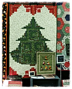 We made the Trim the Tree quilt with Be Jolly Fat Quarters and two of the Creative Grids Trim tool Rulers.  Our lucky winner of this bundle will get this TRIM THE TREE pattern  from Cut Loose Press too!