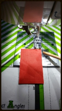"USE WHAT YOU LOVE:  This is my  CLEARLY PERFECT ANGLES  A 'window' cling style  guide that clings to the bed of my machine and helps sew perfect diagonal lines and 1/4"" seams.  I don't ever have to draw lines on my squares. YAY! I love this tool."