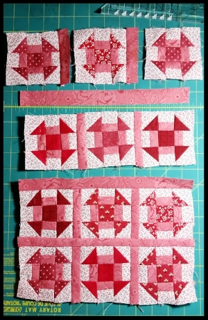 "Layout your blocks in 4 rows of 3, in an arrangement that pleases you. Using a 1"" x WOF sashing strip, Cut 8) 1"" x 3 ½"" pieces. Sew these pieces to the right side of the first 2 blocks in each row. Press toward the sashing. Sew the rows of 3 together and press toward the sashing.  Using the rest of the 1"" sashing strips sew a strip between the rows as pictured."