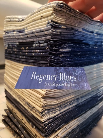 I'm using Christopher's  FAT QUARTER BUNDLE   and  my background is 5 yards of  BELLA SOLID INDIGO 9900 218   But you could also use one  REGENCY BLUES FAT EIGHTHS BUNDLE  and one  REGENCY BLUES CHARM PACK  and 5 yards of background for the BLockheads2 quilt.