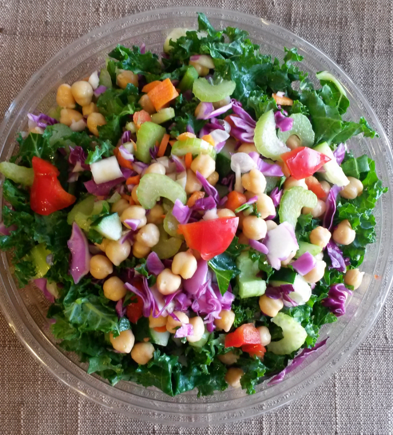 Kale salad with garbanzo beans, red cabbage, red bell peppers, celery, carrots, cucumber, and of course kale. I used italian dressing but you can use anything really.