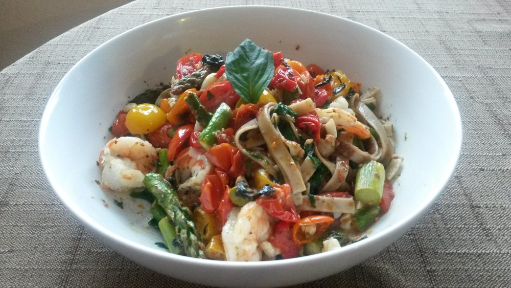 Whole wheat high fiber/protein pasta with fresh basil, asparagus, cherry tomatoes, shrimp, olive tapanade, and olive oil.