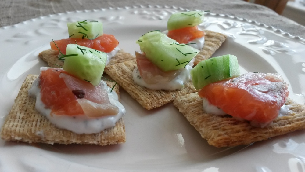 Triscuit crackers, yogurt , smoked salmon, cucumber and fresh dill.