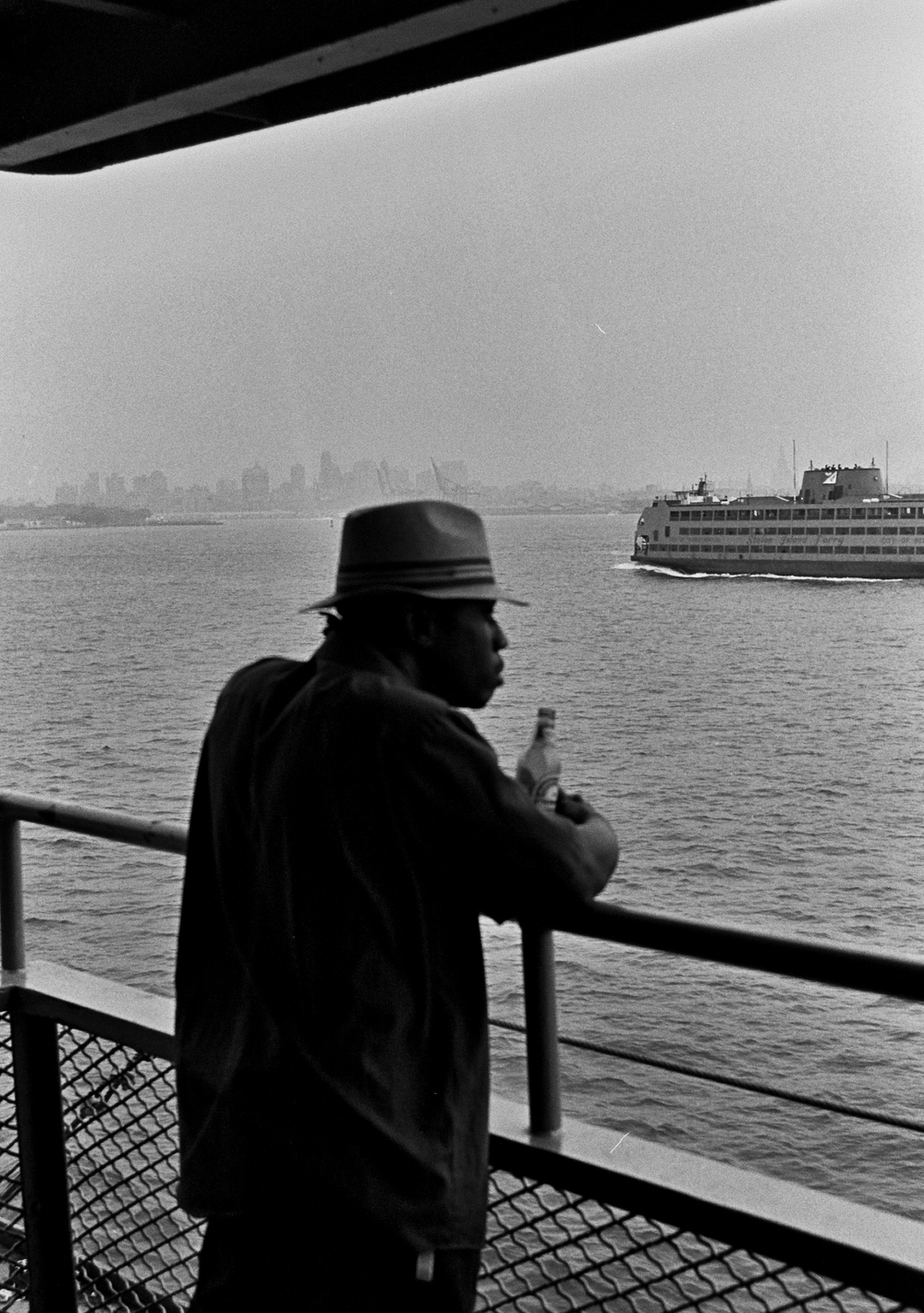 Man on ferry, New York, NY