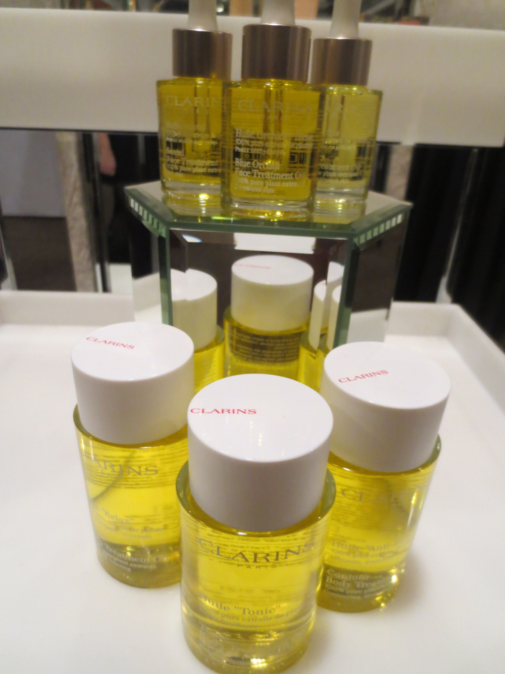 Clarins's famed Tonic treatment body oil and Blue Orchid face treatment oil.