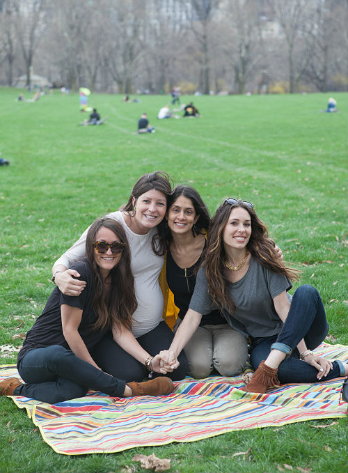 After a long day of travel, besties unite in the Sheep Meadow in Central Park.