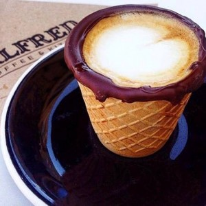 A cappuccino in a chocolate-dipped waffle cone from Alfred in the Alley.
