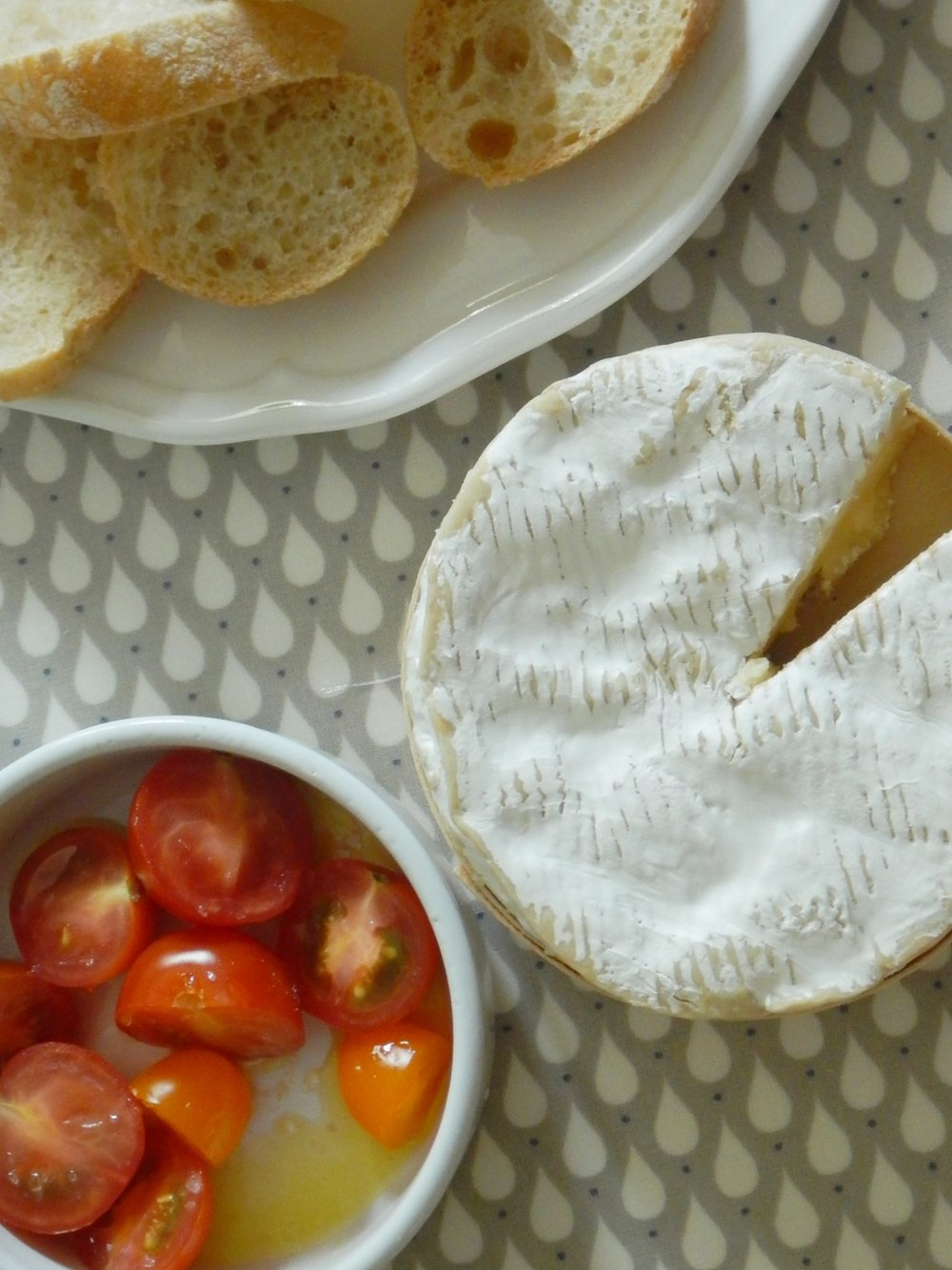 Fresh tomatoes in regional olive oil with fleur du sel, a sliced baguette, and the most pungent camembert you could ever imagine.