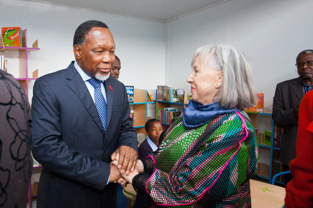 Deputy President Kgalema Motlanthe congratulates Jenny Crwys-Williams.