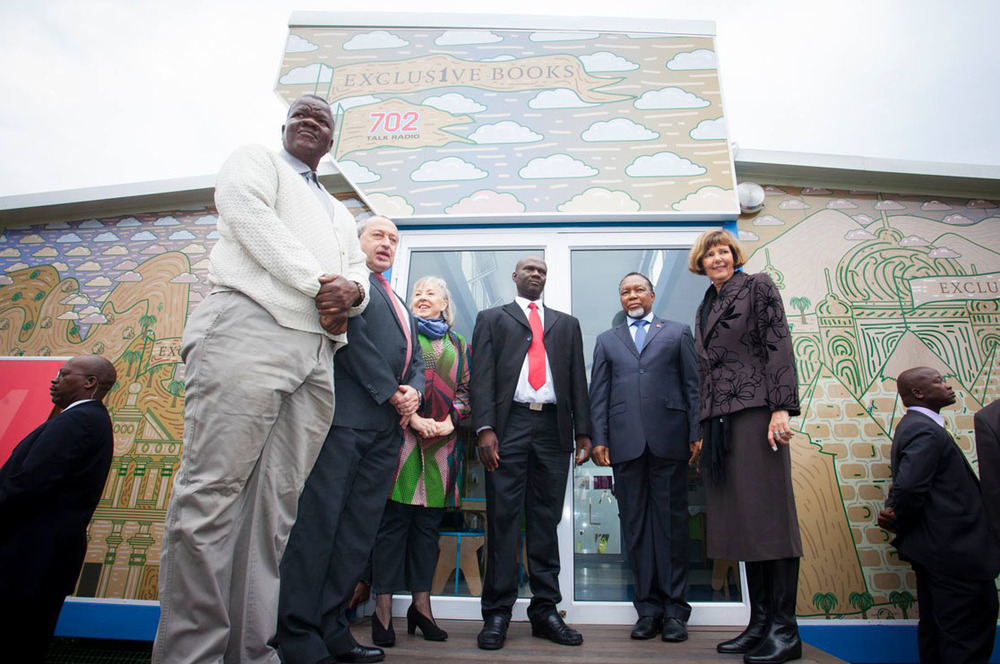 Deputy President Kgalema Motlanthe and Jenny Crwys-Williams joined by the Gauteng Education MEC and other officials outside the brand new SEED Library.