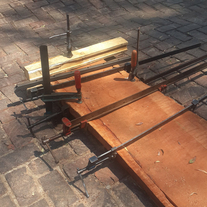 GLUING a really really really long plank of wood to make a table