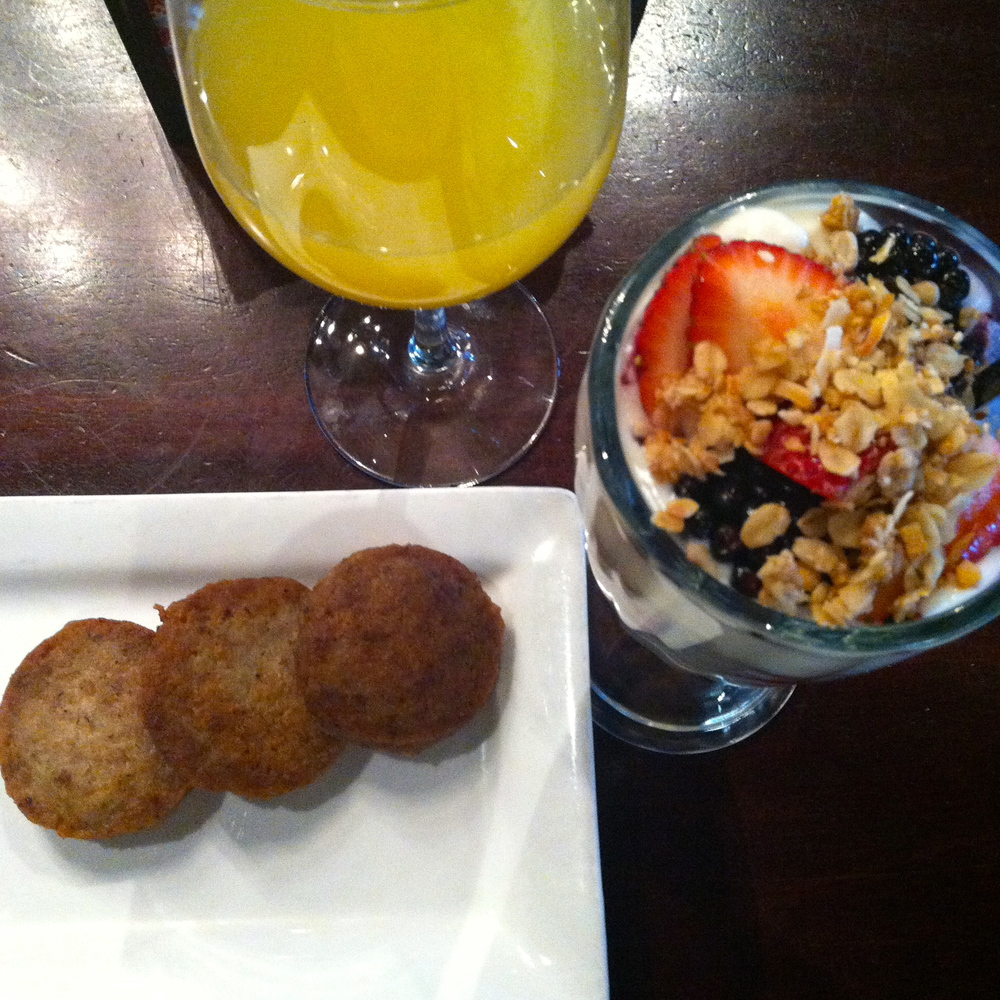 My parfait and sausage. Plus the gratuitous mimosa shot. Still no bottom in sight...