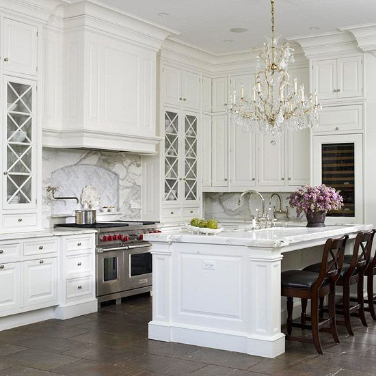 its not the first post on this theme and it wont be the last the bright white chandelier adorned kitchen although i find marble tops incompatible with