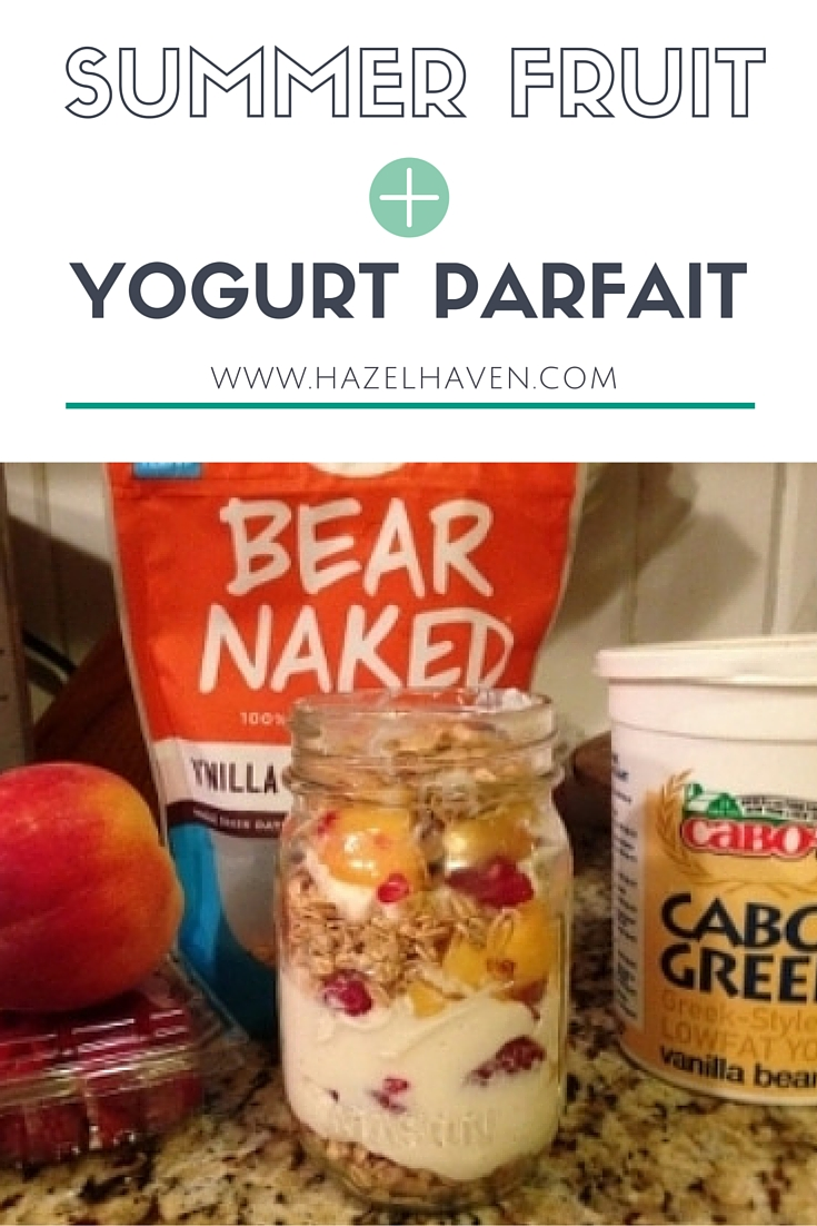 peach and raspberry yogurt parfait in a ball mason jar