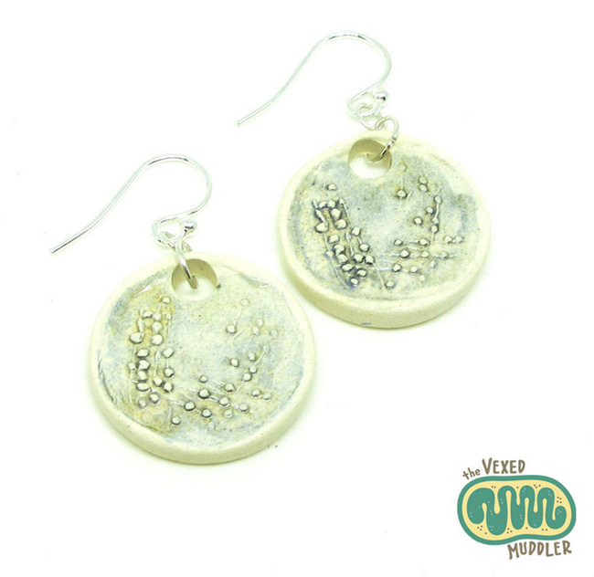 These Petri dish earrings are handcrafted and hand painted to resemble a bacterial culture streaked out on a petri plate.
