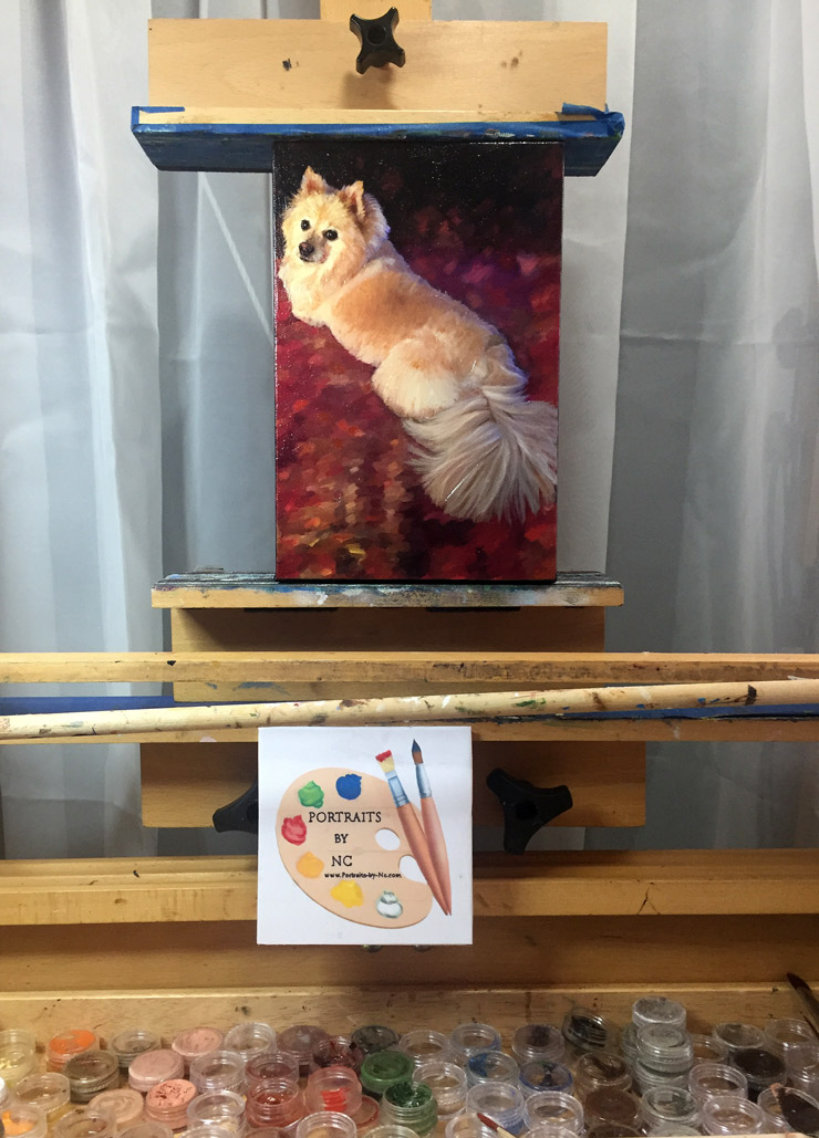 Pomeranian on easel