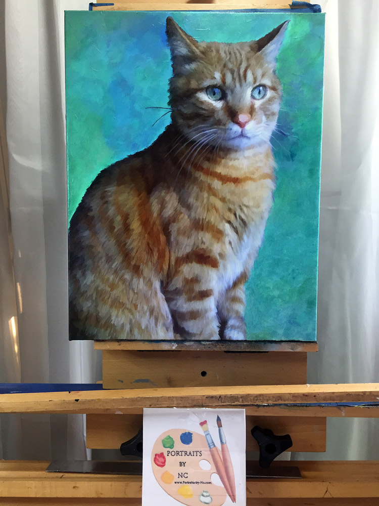cat painting on easel
