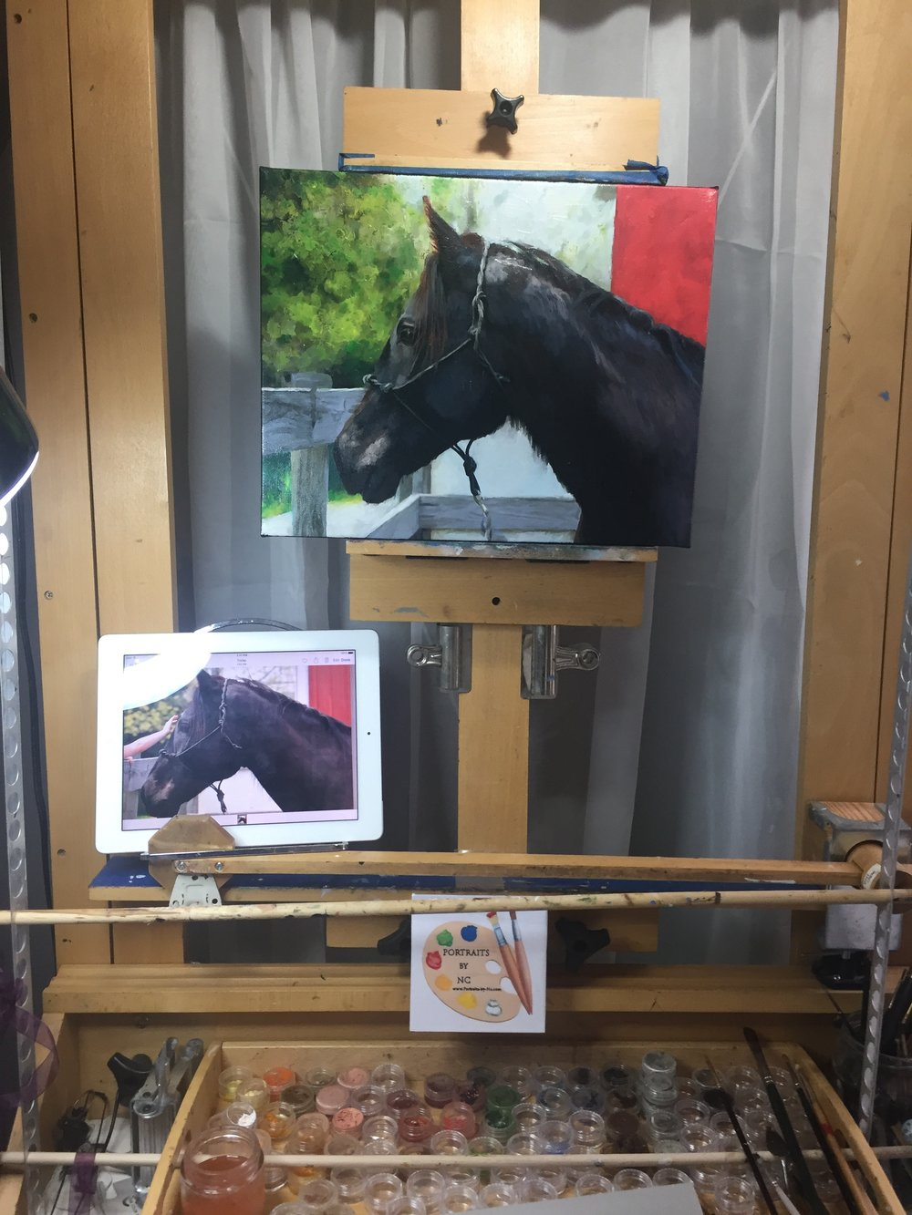 horse painting on easel